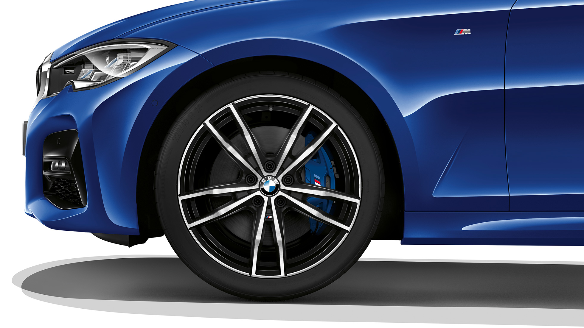 Close-up of the light alloy wheel of the BMW 3 Series Sedan with Model M Sport equipment.