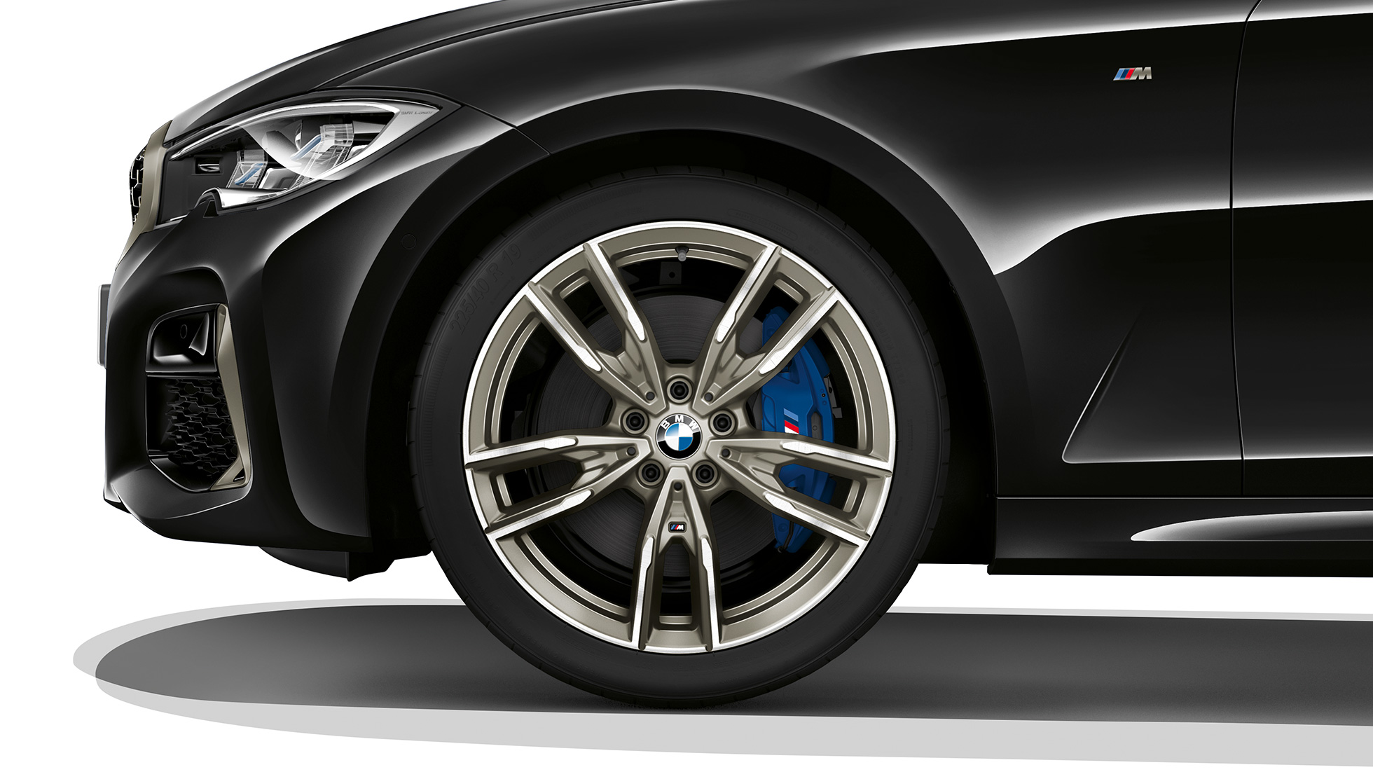 Close-up of the light alloy wheel of the BMW 3 Series M340i xDrive Sedan.