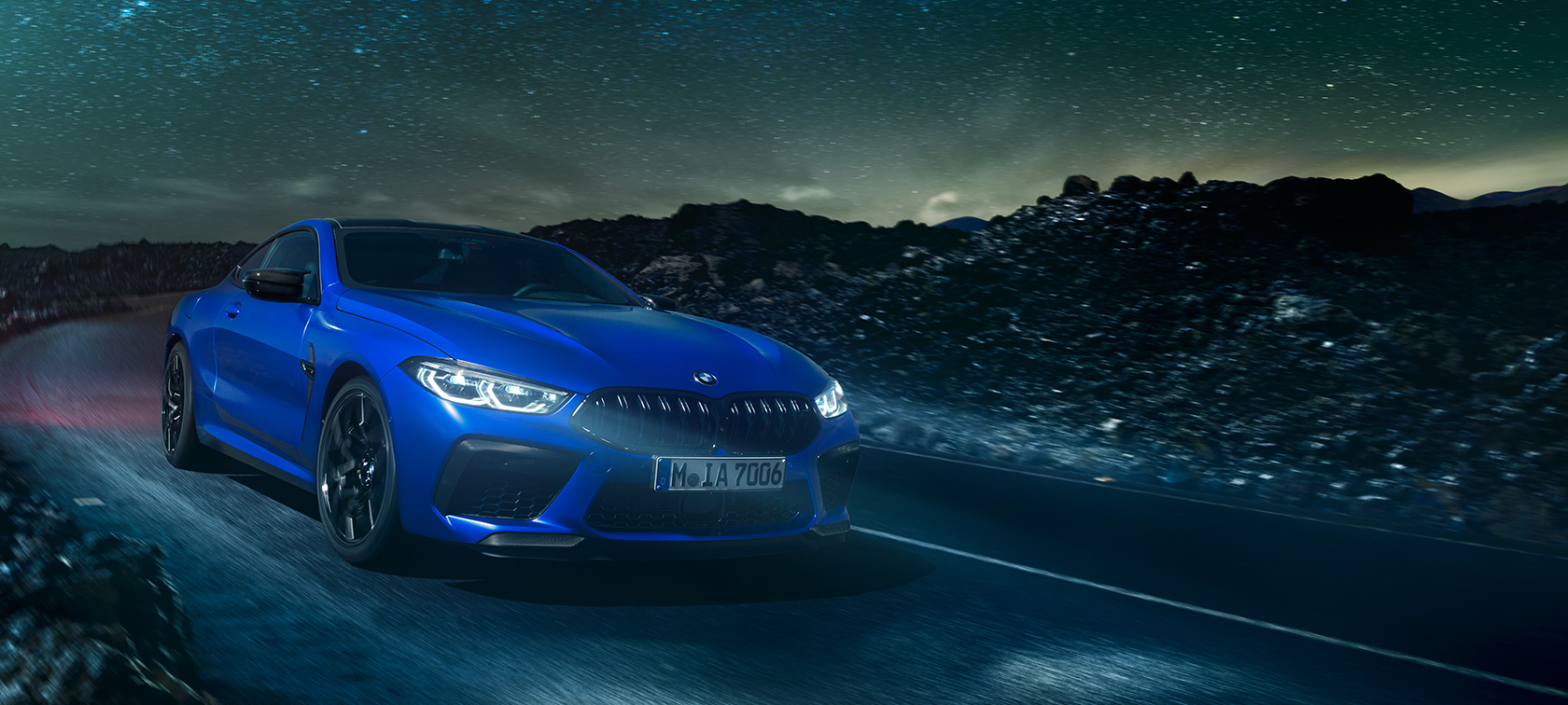 The first-ever BMW M8 Competition Coupé in Marina Bay Blue metallic, three-quarter front view.
