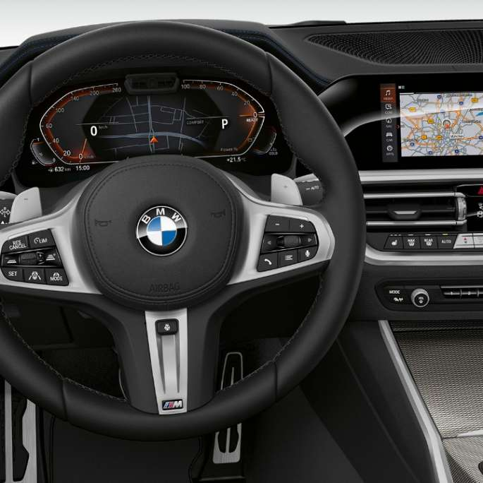 Frontal close-up of the driver's cockpit of the BMW 3 Series Sedan with Model Sport Line features.