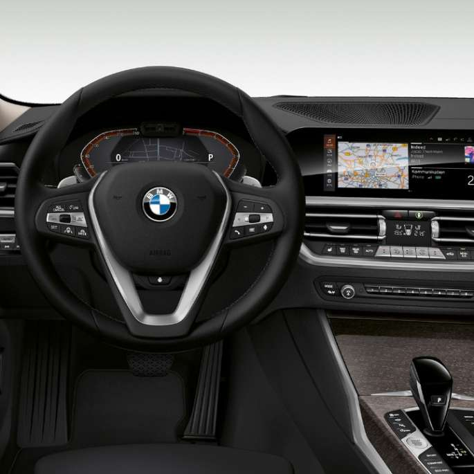 Frontal close-up of the driver's cockpit of the BMW 3 Series Sedan with Model Luxury Line features.