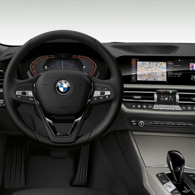 Frontal close-up of the driver's cockpit of the BMW 3 Series Sedan with model Advantage features.
